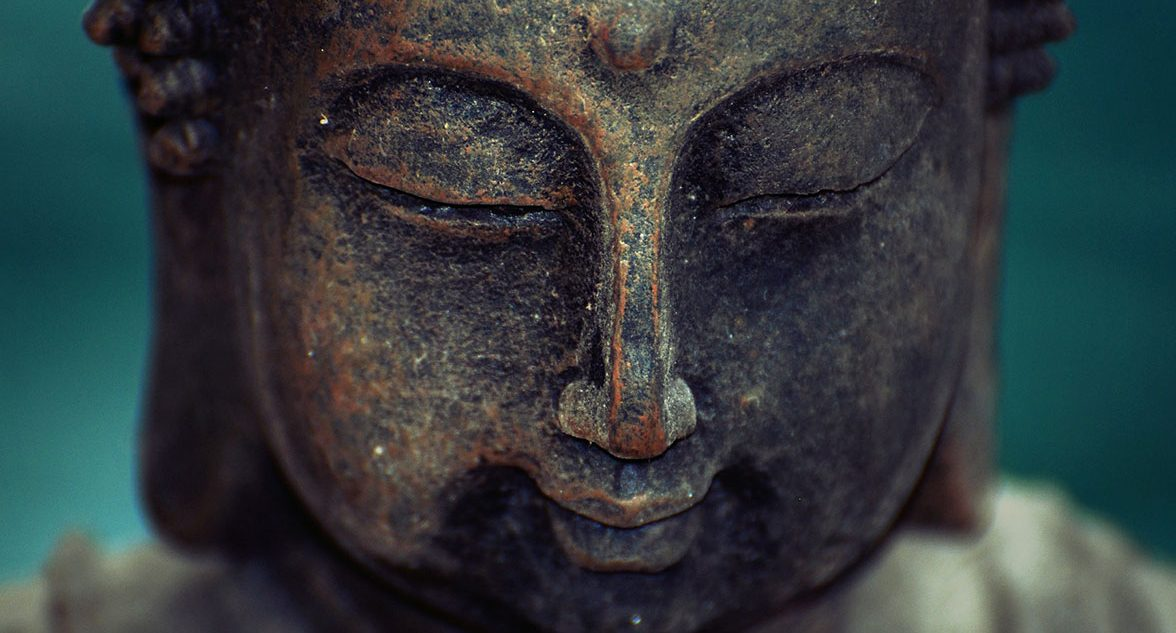 compassionate buddha face closeup with eyes closed